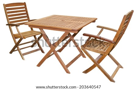 Set of folding wooden garden furniture - table and chairs isolated on white and with clipping path - stock photo