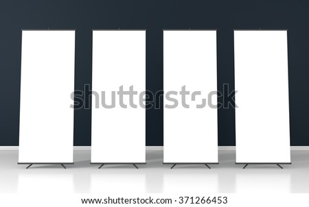 Set of four blank roll up posters - vertical billboard for text on dark purple background - stock photo