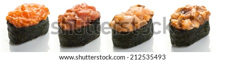 Set of four sushi with tuna, yellowtail, salmon and ugr?muntsom and spicy sauce in nori on a white background close up isolated - stock photo