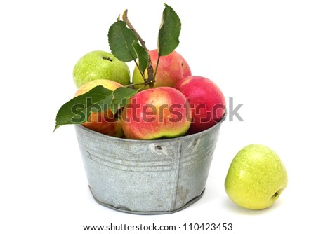 Set of fresh apples in metallic bowl isolated on white background - stock photo