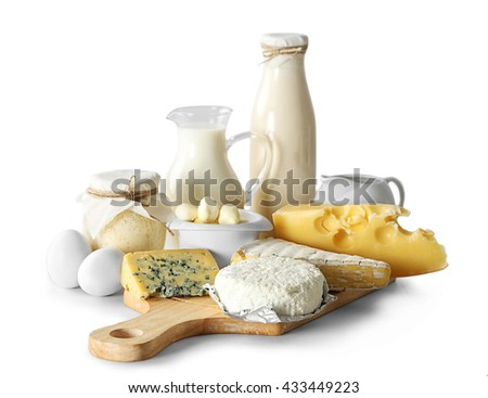 Set of fresh dairy products on wooden board, isolated on white - stock photo