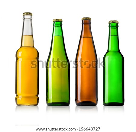 Set of full beer bottles with no labels isolated on white background - stock photo