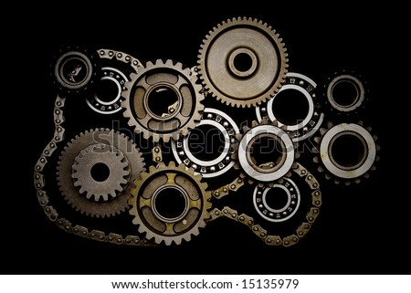 Set of gears, ball-bearings and chain isolated on black background - stock photo