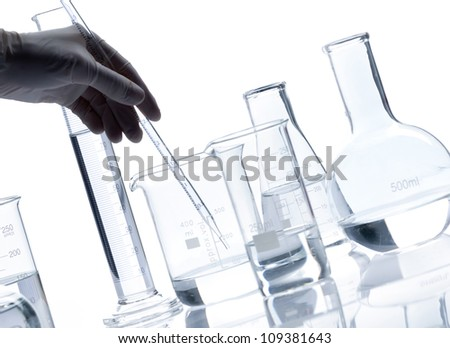 Set of glass flasks with a clear liquid, isolated - stock photo