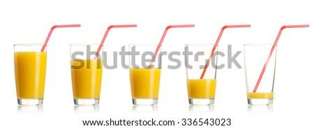 Set of glass of fresh orange juice with straw on white background - stock photo