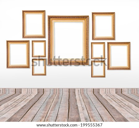 Set of gold vintage picture frames on the wall inside the room - stock photo