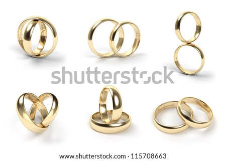 Set of gold wedding rings engraved with the text Newlyweds - stock photo