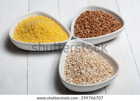 Set of groats from barley, millet and buckwheat - stock photo