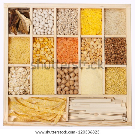 Set of groats in wooden box - stock photo