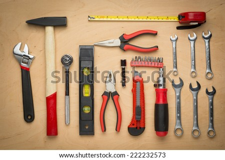 Set of hand tools on a wooden panel close up - stock photo