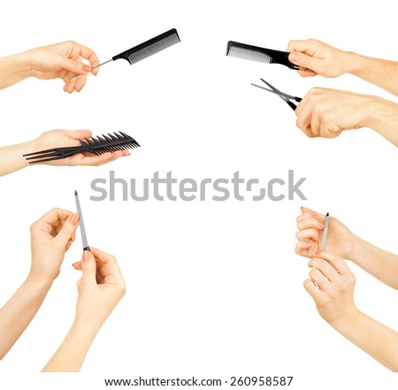 set of hands holding a pair of scissors, a comb and nail file on - stock photo