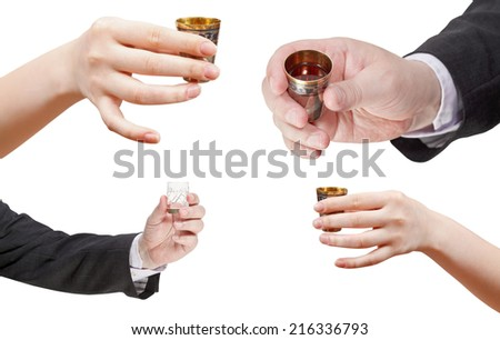 set of hands with glass of spirits isolated on white background - stock photo