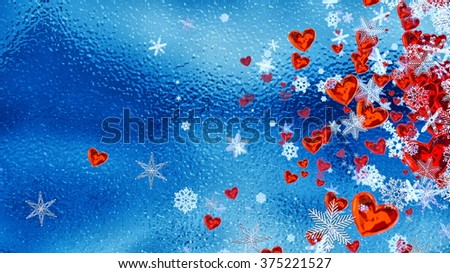 Set of hearts and snowflakes with a blue ice backdrop as a symbol of romantic love for the congratulations on Valentine's Day in february and winter weddings. Abstract horizontal background. - stock photo