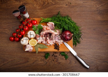 set of ingredients at wooden board for coocking meat meal - stock photo