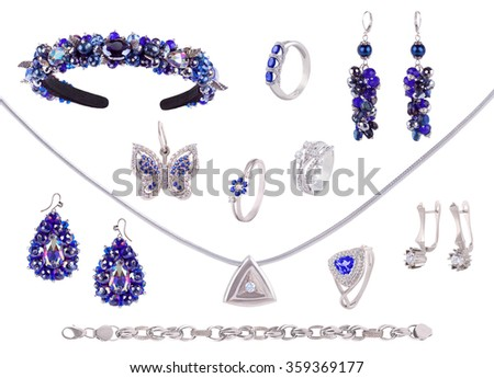 Set of jewelry items. White Gold silver and blue gemstones diamonds precious accessorize - tiara, necklace,  ring, earrings, bracelet isolated on white - stock photo