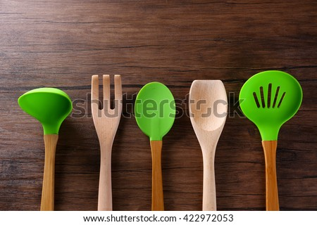 Set of kitchen tools on wooden table - stock photo
