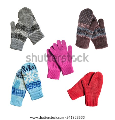 Set of knitted wool mittens and gloves on white background - stock photo