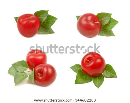 Set of large fresh ripe plums nectarines with green leaves, healthy ingredient isolated on white background. - stock photo
