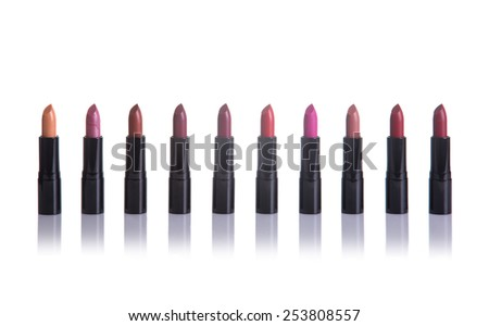 Set of lipsticks in fashionable colors, isolated on white background with natural reflection  - stock photo