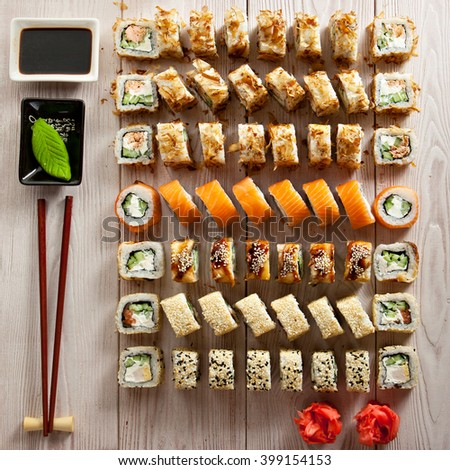 Set of Maki Sushi on Wooden Background - stock photo