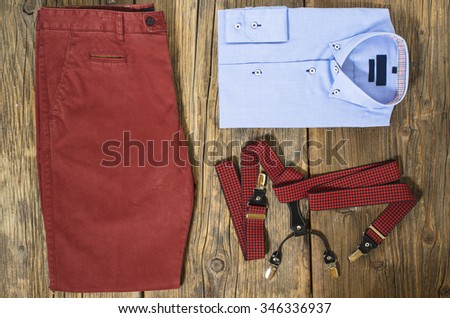 Set of man casual clothes on wooden table. Top view - stock photo