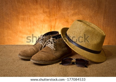 set of men's accessory, boots, panama hat and sunglasses - stock photo