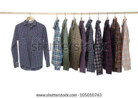 Set of Men's different sleeved plaid cotton on a wooden hanger - stock photo