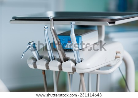 Set of metal medical equipment tools for teeth dental care - stock photo