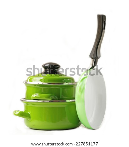 set of metal pots and pan cookware on a white background - stock photo