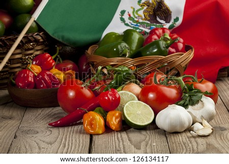 Set of mexican vegetables arranged in table with a mexican flag - stock photo