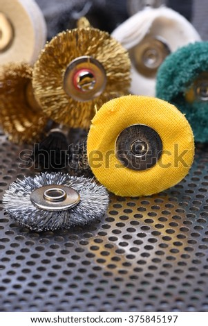 Set of mini rotary drill tools on metal surface - stock photo
