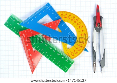 Set of multicolored lines of triangles, protractors and Caliper. On a white background. - stock photo