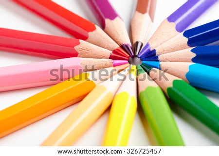 Set of multicoloured pencils lying on white table round order. Creativity, art skill and school, variety of possibilities, game of imagination and fantasy, make world vivid and impressive concept - stock photo