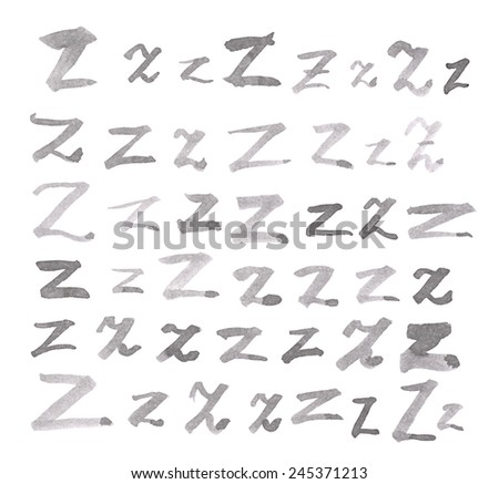 Set of multiple hand drawn with black watercolor ink Z letters isolated over the white background - stock photo