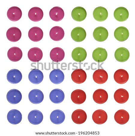 Set of multiple round candles, top view above, isolated over the white background - stock photo