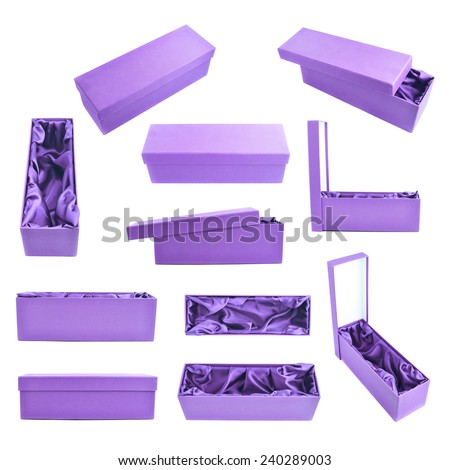 Set of multiple violet tall gift boxes with the velvet cloth inside, isolated over the white background - stock photo