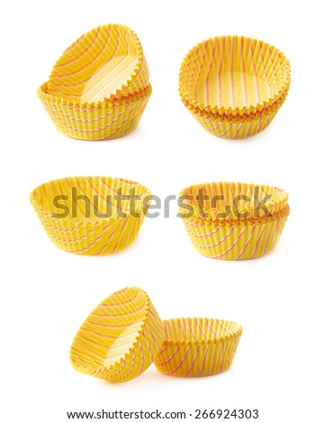 Set of multiple yellow striped cupcake paper cups, isolated over the white background - stock photo