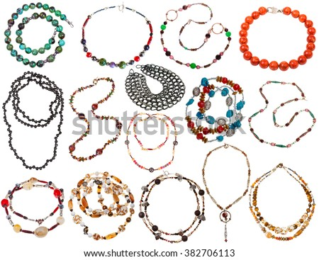 set of necklaces from natural gemstones, coral, pearl, bone, chain, beads isolated on white background - stock photo