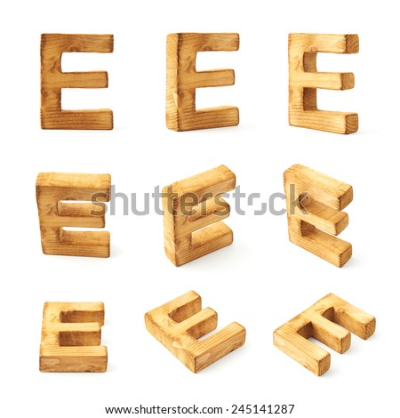 Set of nine block wooden capital E letters in different foreshortenings isolated over the white background - stock photo