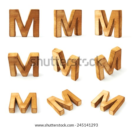 Set of nine block wooden capital M letters in different foreshortenings isolated over the white background - stock photo