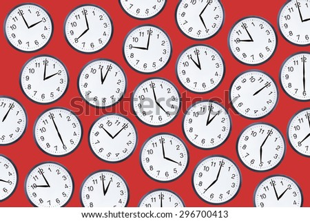 Set of office clocks showing various time on red background. Alarm or deadline concept - stock photo