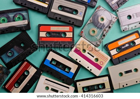 Set of old audio cassettes on blue background - stock photo