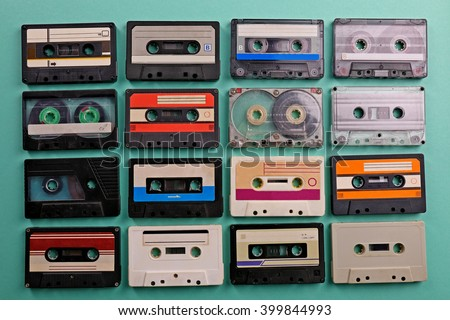 Set of old audio cassettes on turquoise background - stock photo