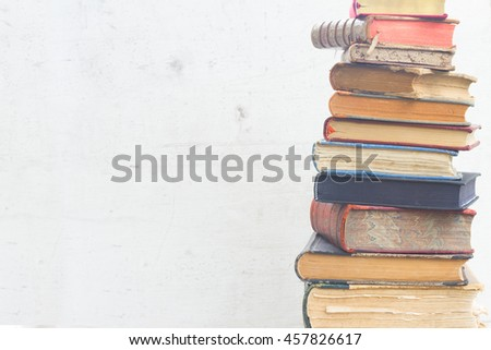 set of old books close up on white wooden background - stock photo