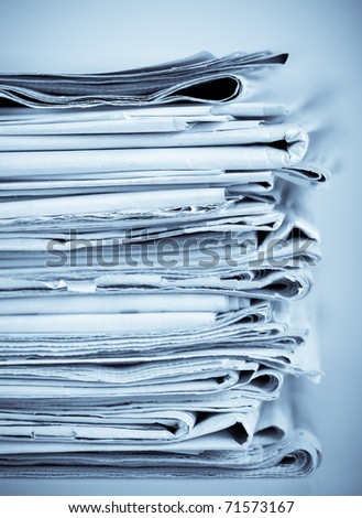 Set of old newspapers combined by a pile - stock photo