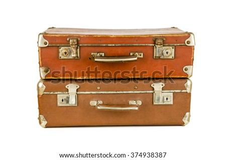 Set of old suitcases. Brown retro suitcase. Vintage baggage. Vintage travel bags. - stock photo