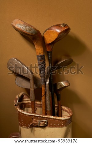 Set of old vintage golf clubs in bag - stock photo