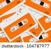 set of orange audio cassettes background. - stock photo