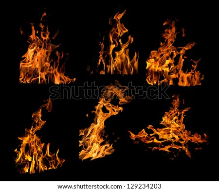 set of orange flames isolated on black background - stock photo