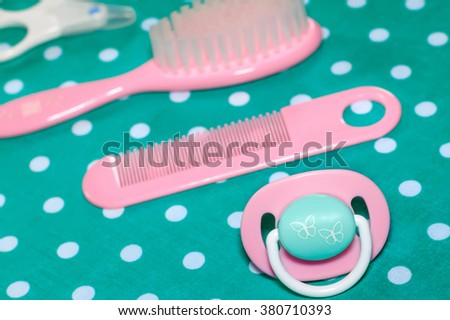 Set of pacifier and brushes for newborn babies - stock photo